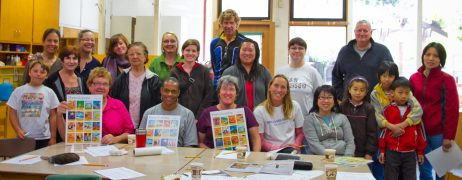 About 20 volunteers for the Alemany Island mural painting class
