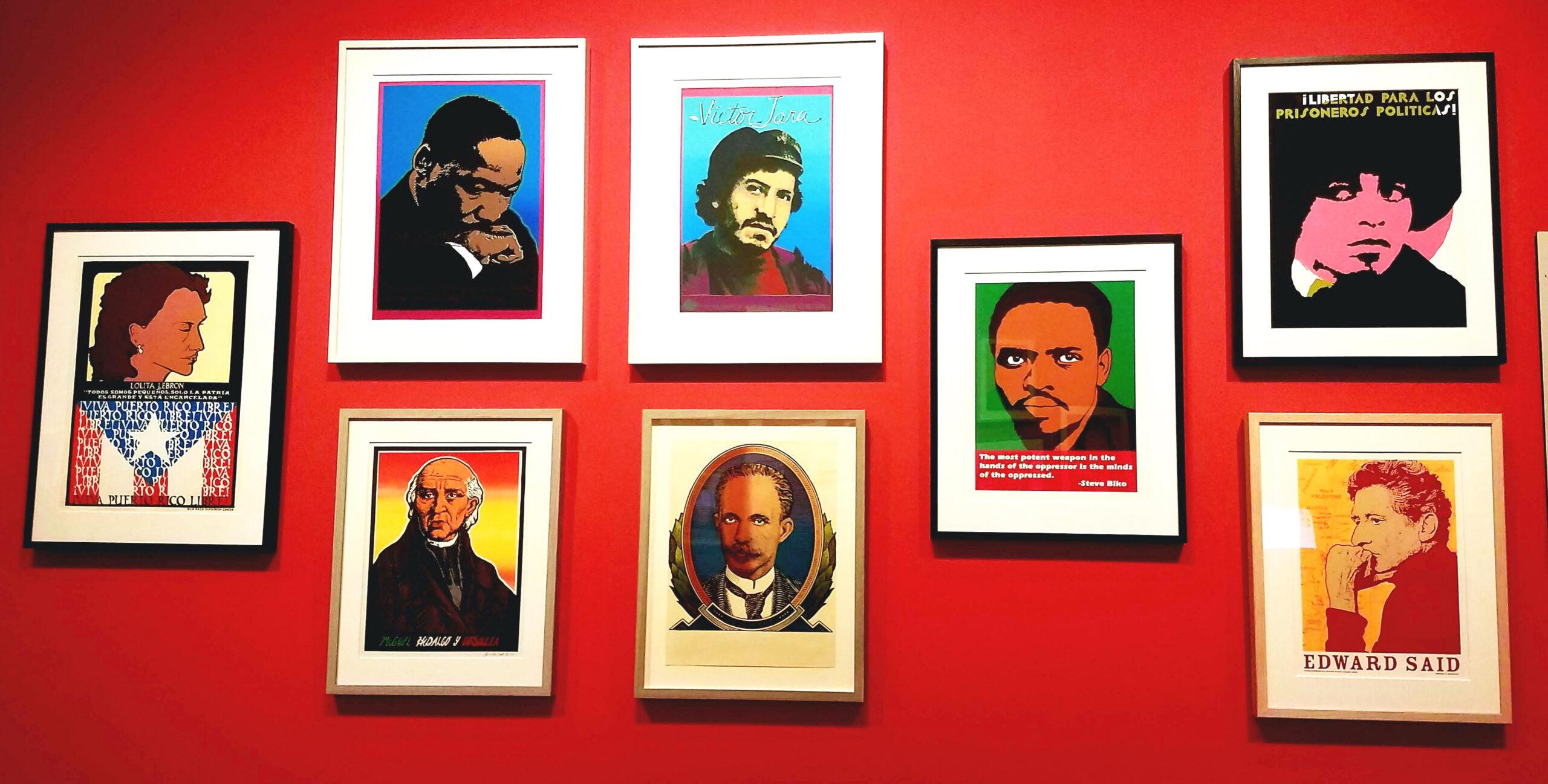 a red museum wall with silkscreened portraits of Lolita Le Born, Angela Davis, MLK, José Martí, Victor Jara, Edward Said and Miguel Hidalgo de Costilla