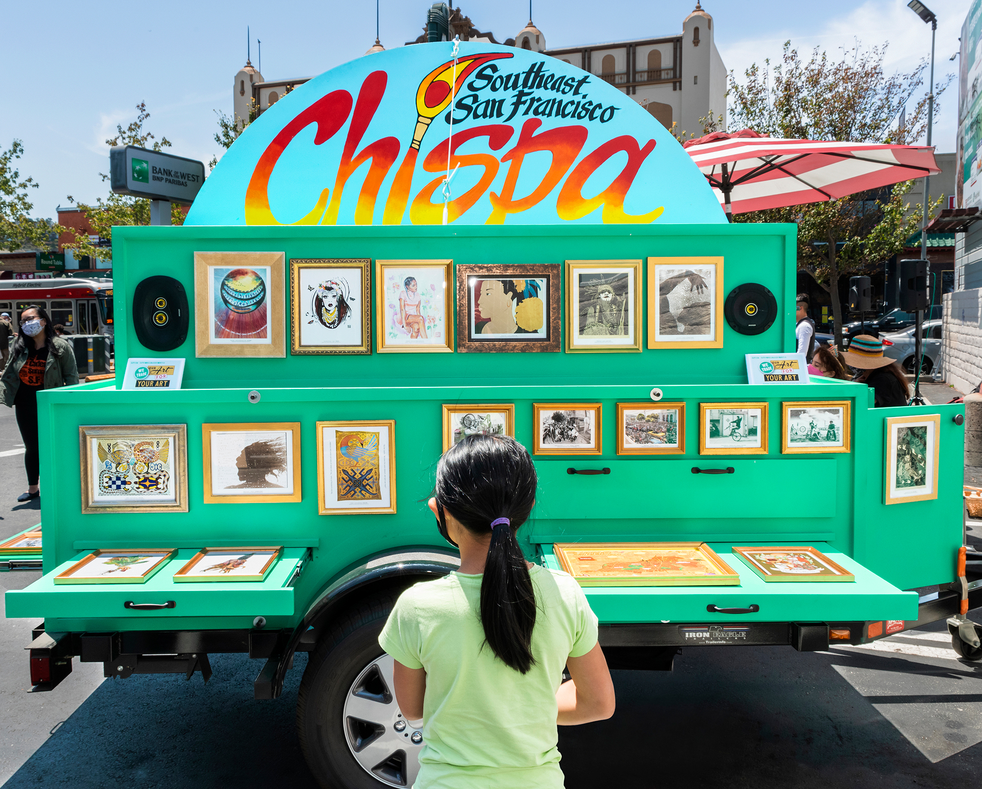 The Chispa Art Cart with a young participant in front.